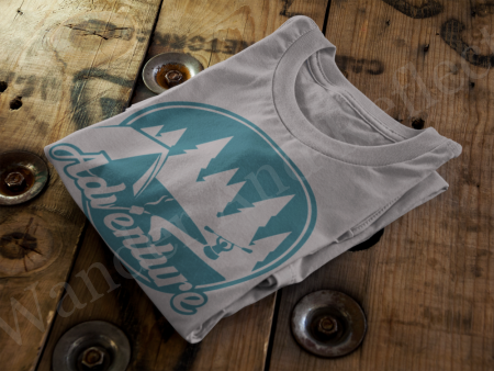 Turquoise adventure design on a gray tshirt.