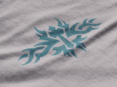 Turquoise tribal cross t-shirt.