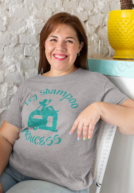 Dry shampoo princess lounges on the roof of a vintage camper on this emerald on gray tshirt.