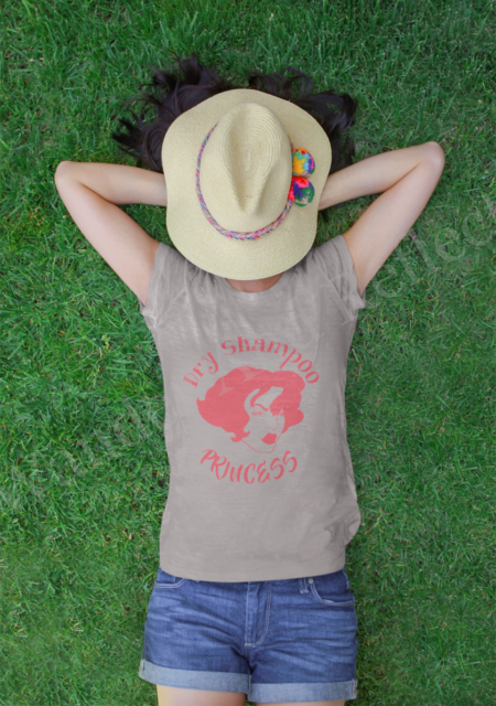 Our dry shampoo princess is wearing a heather gray tshirt with hybiscus graphics.