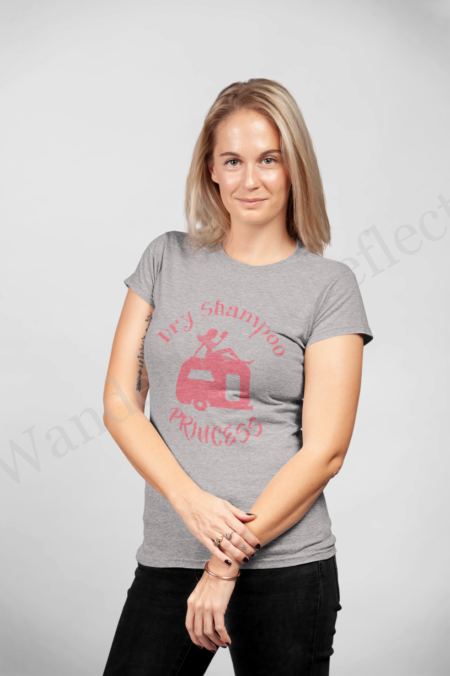 Looking good in our hibiscus on heather gray tshirt of a woman laying on the roof of a camper with her waterless shampoo.