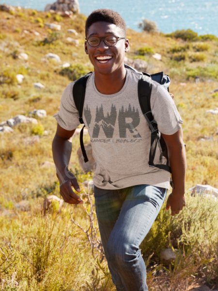 Bruce goes hiking in his wander and reflect crew neck shirt.