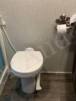 Toilet in a fifth wheel recreational vehicle.
