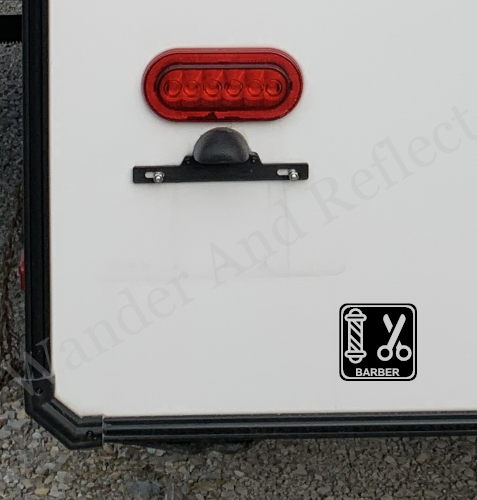 Show you're a barber with this vinyl sticker for your camper bumper.