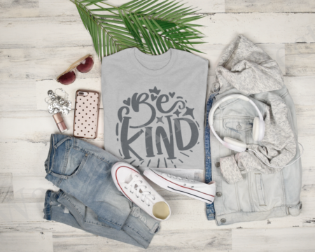 Charcoal gray text on light gray shirt reminds you to be kind.
