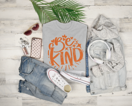 Orange text on light gray shirt reminds you to be kind.
