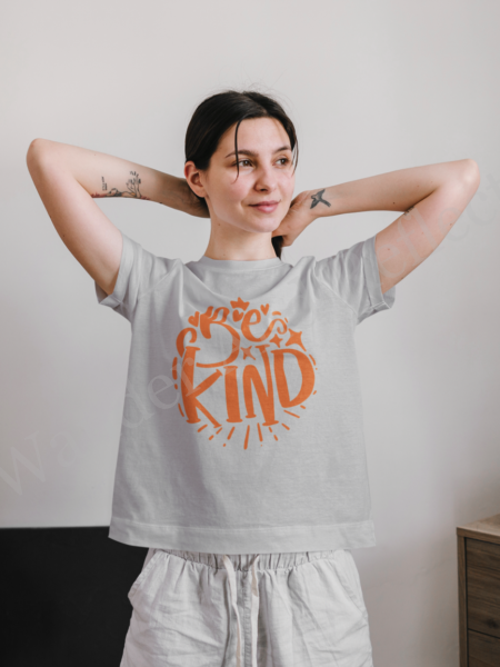 Pumpkin orange text on gray t-shirt asks us to be kind.