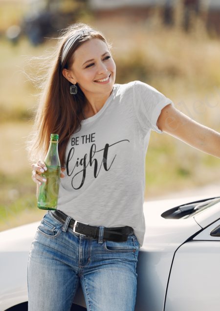 Be the light in this gray t-shirt with flat black graphics.