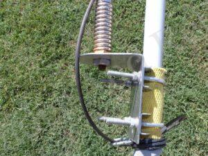The weBoost ladder mount being attached to a fiberglass telescoping flag pole.