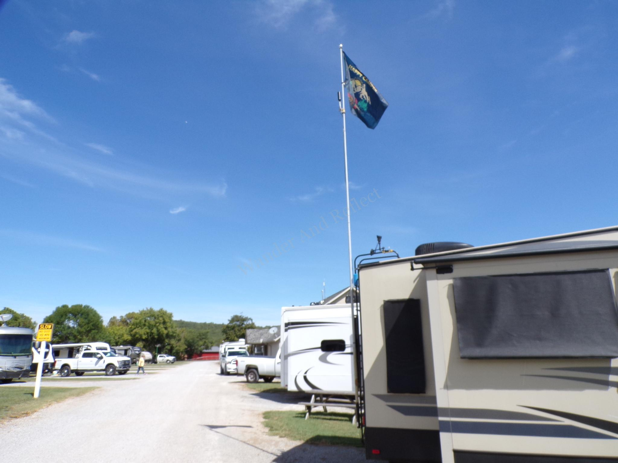 Cell phone internet signal booster on an RV flag pole.