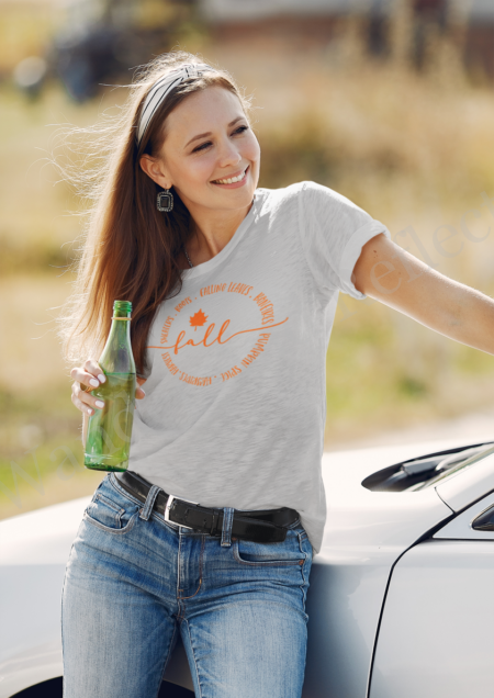 Fall tshirt with pumpkin orange text listing hayrides, leaves, boots and sweaters.