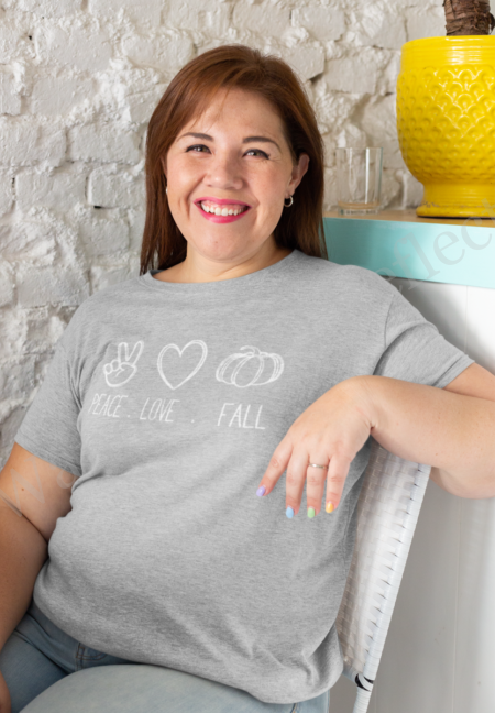 White graphics on an athletic heather gray t-shirt with a peace sign, heart and pumpkin.