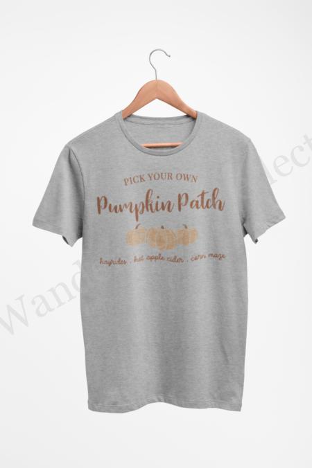Cashew colored pumpkins with hazelnut text on a gray shirt.
